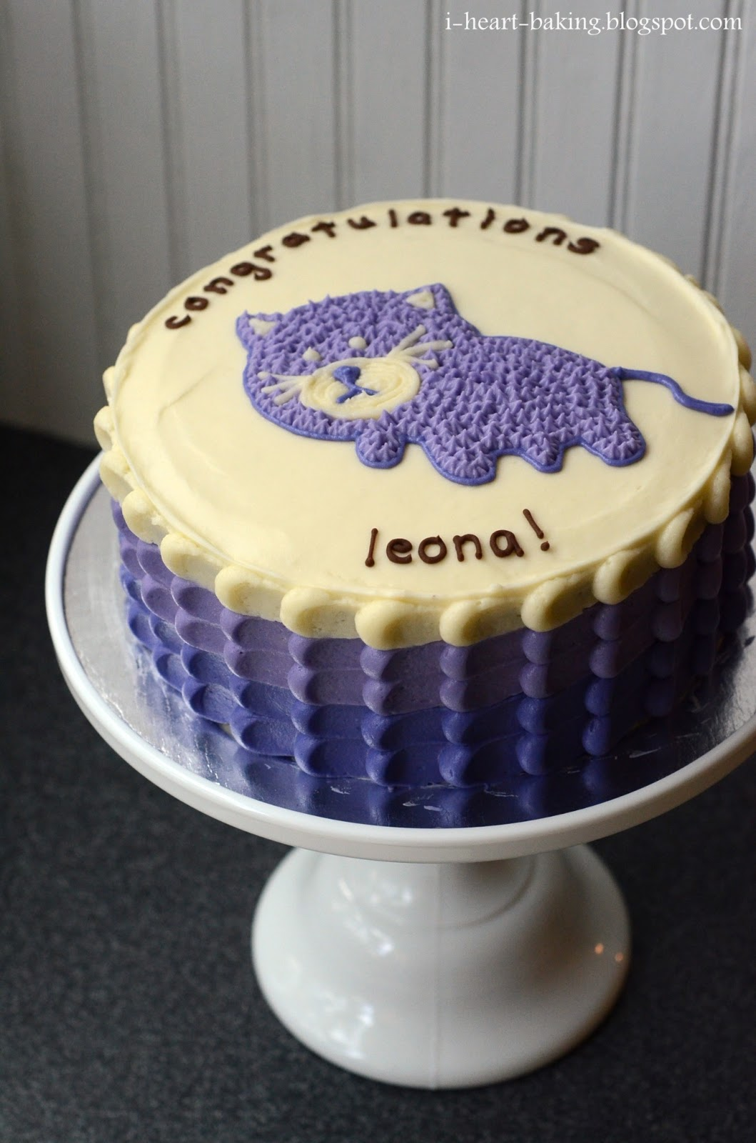 purple cat baby shower cake with petal sides