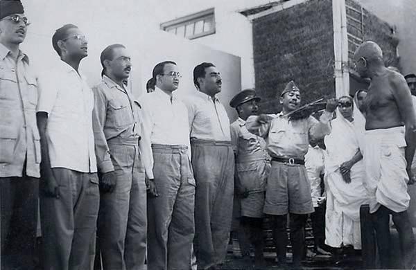 Capt. Ram Singh Thakuri seen here welcoming Mahatma Gandhi along with his fellow INA mates