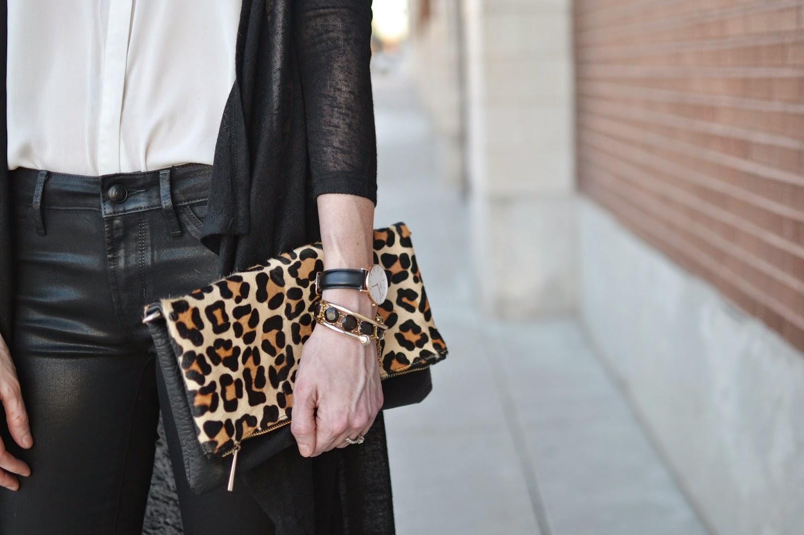 black coated skinny jeans, white blouse, black duster cardigan, leopard clutch