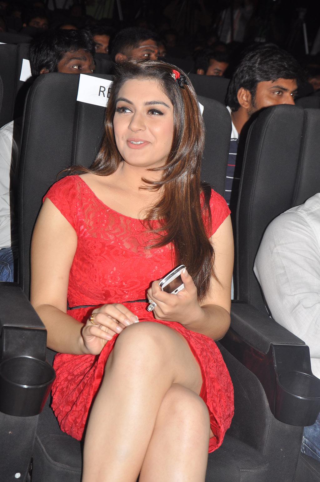 Hansika Motwani Showing Her Cute Legs At Telugu Film 'Settai' Audio Launch