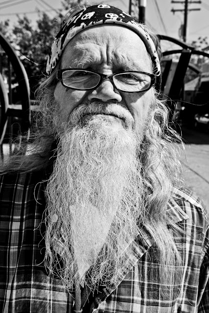 An older dude in Greeley, Colorado with a long white beard.
