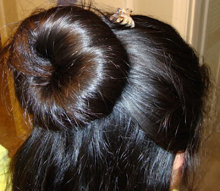 long hair buns by Indian girl