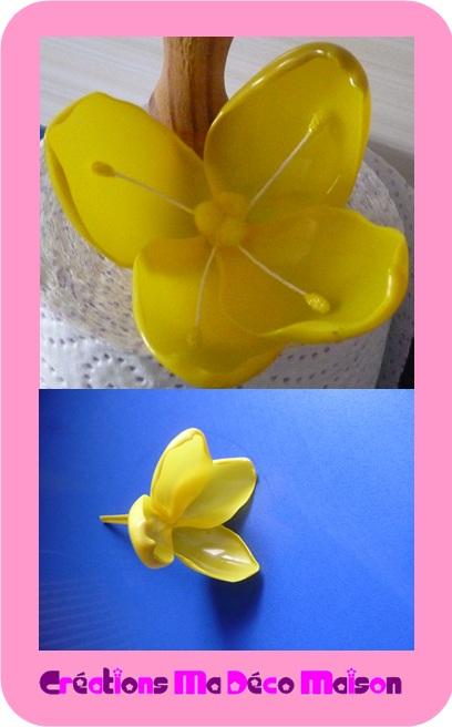 fleur jaune faite en cuill res en plastique cr ations ma. Black Bedroom Furniture Sets. Home Design Ideas
