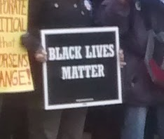 #BlackLivesMatter supporter at the march!  Climate Change affects everyone regardless of Race, Creed, or Community Status