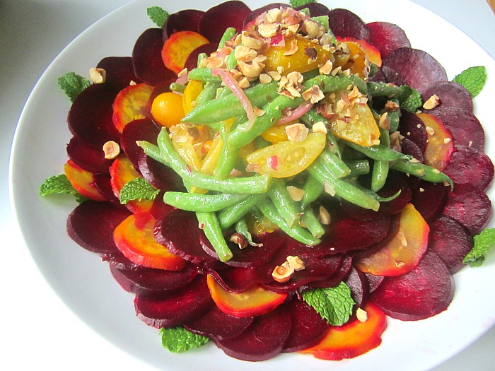 garden beets, roasted and sliced thin with a plate of marinated green ...