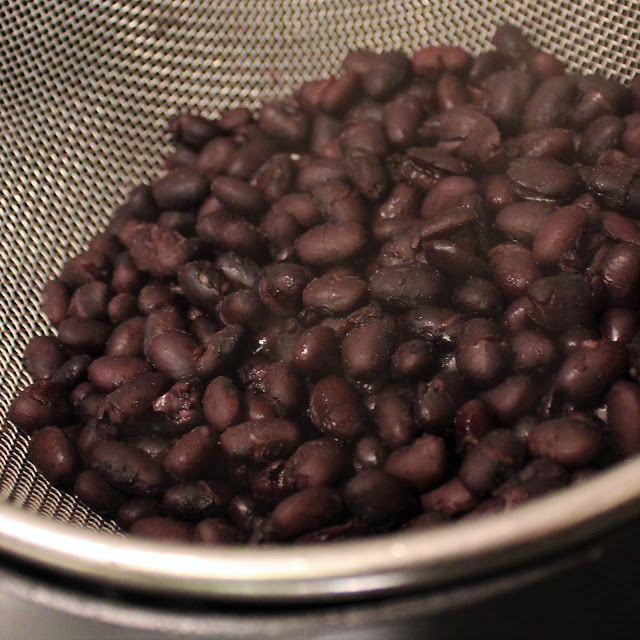 Black beans in sieve