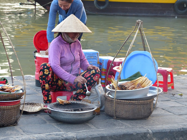 Vietnamese woman wearing conical palm leaf hat