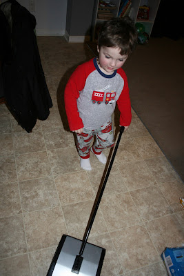 toddler sweeping with Bissel sweeper