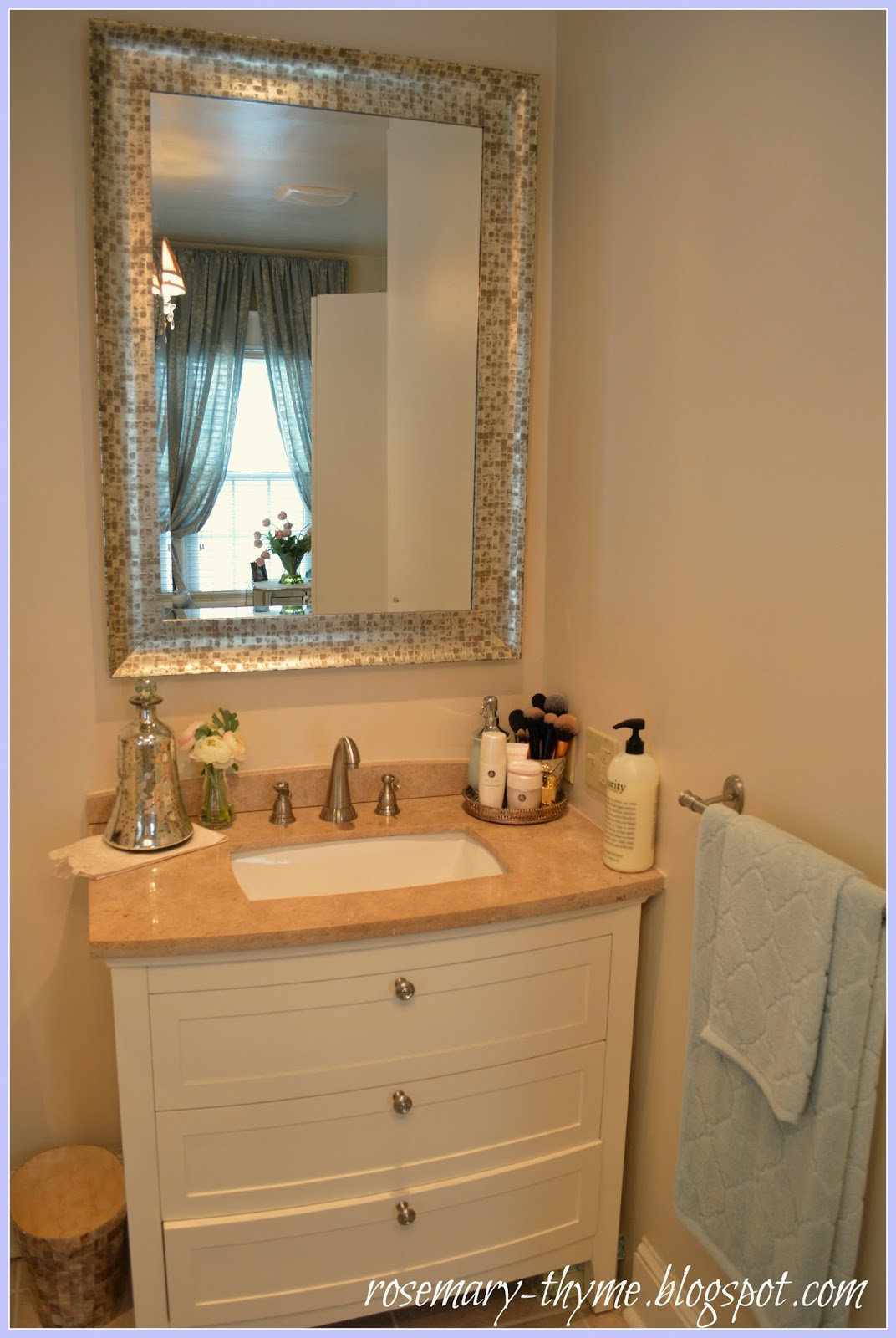 Mercury accessories  faux flowers and vintage pieces give the room romance  and a feminine appeal. Creating A Romantic Spa Bathroom On a Budget