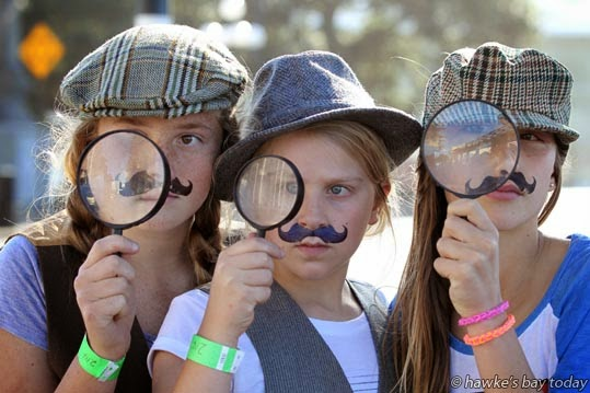 L-R: Emily Wakely, Napier, with her cousins from Hamilton, Sophie Holten, Olivia Holten, on Marine Parade, Napier, taking part in a Locals Day i-Spy Fun Challenge, run by Napier i-SITE. photograph