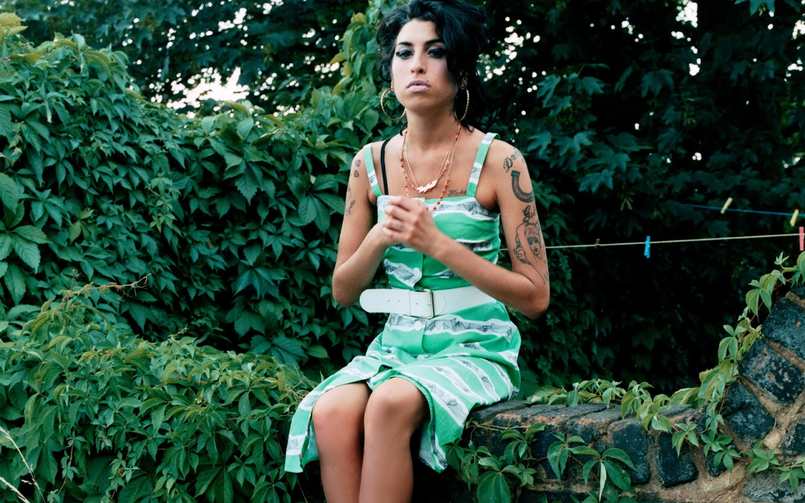 Amy Winehouse Sitting in Garden