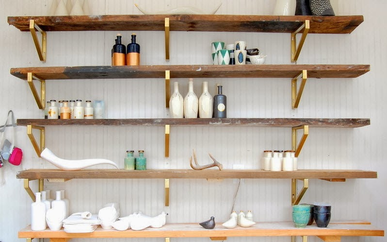 Gold brackets and rustic shelves