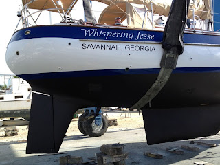 Whispering Jesse getting bottom paint--almost ready to go!