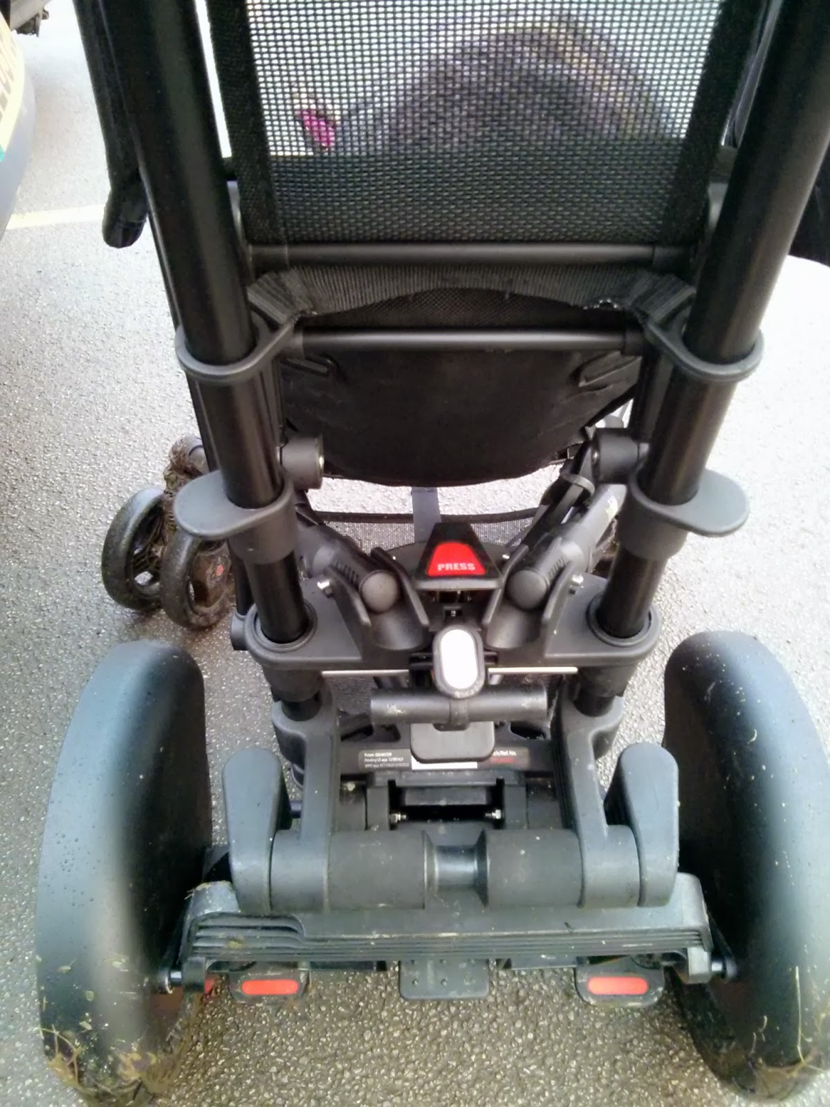 Back view of Micralite Twofold with seat lie down