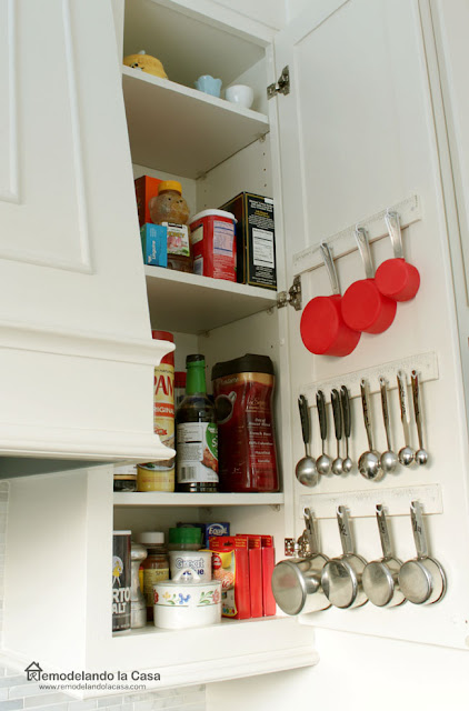 how to install cabinet door measuring cups and spoons organized