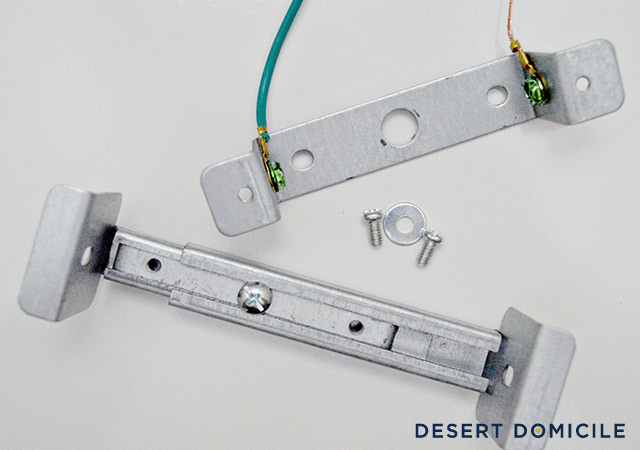 You're going to stretch the bottom brace (shown above) out across the  recessed light until it's snug against the sides. Then you're going to  tighten the ... - How To Turn A Recessed Light Into A Hardwired Light Desert Domicile