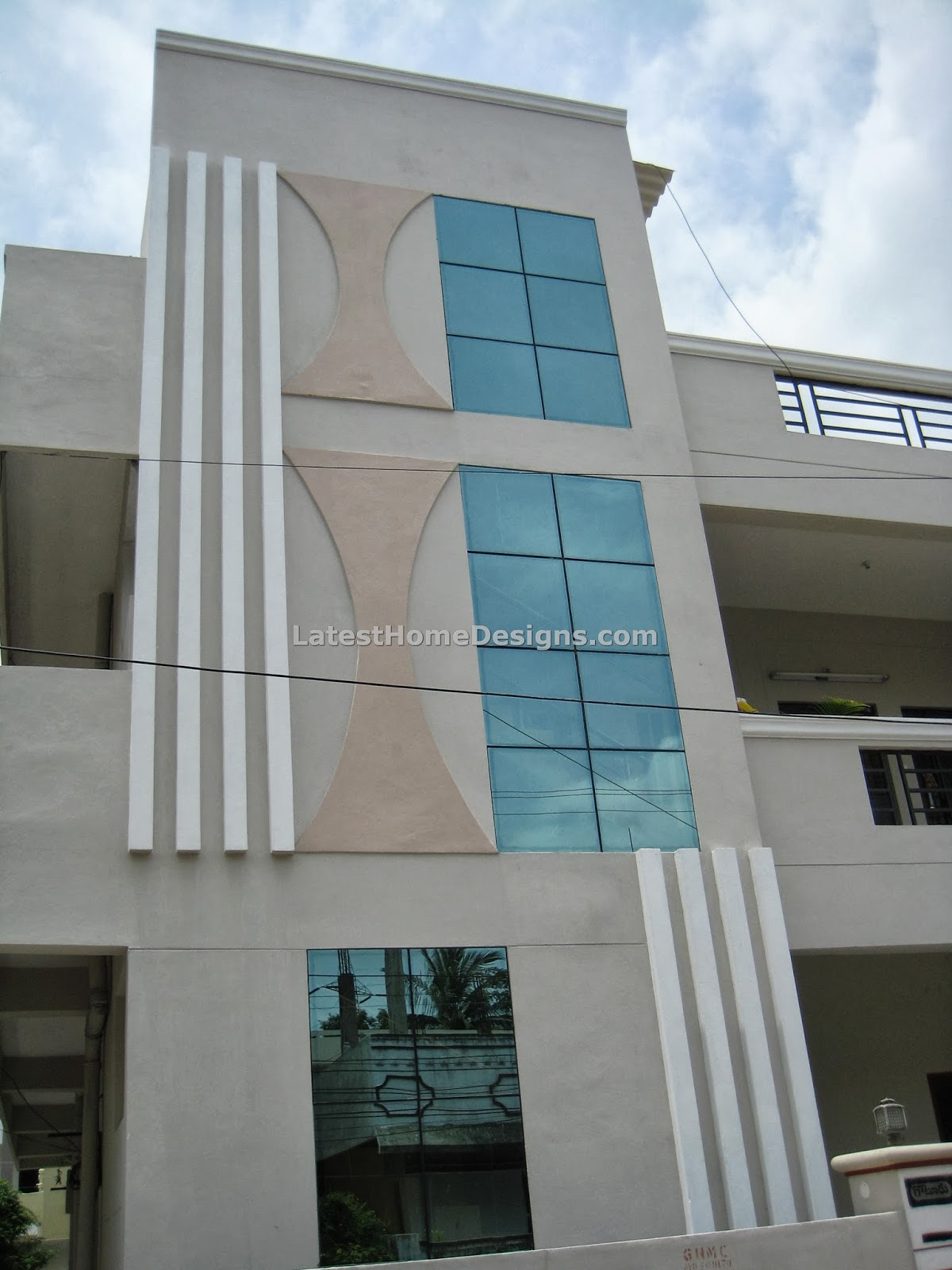 floor building elevation with glasses and cement bars design India