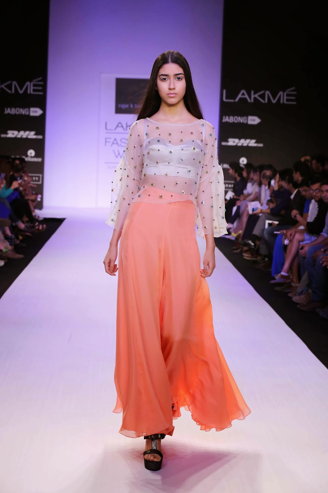"The classic retro Hollywood looks created around divas like Grace Kelly and Audrey Hepburn inspired Rajat Tangri for his ""Garden of Eden"" collection at Lakmé Fashion Week Summer/Resort 2014. Offering a high-end elegant cocktail line with his dramatic distinct touches; Rajat worked around a colour palette of luscious gold ochre, dove grey, vintage mint with neon peach adding a pop of colour."