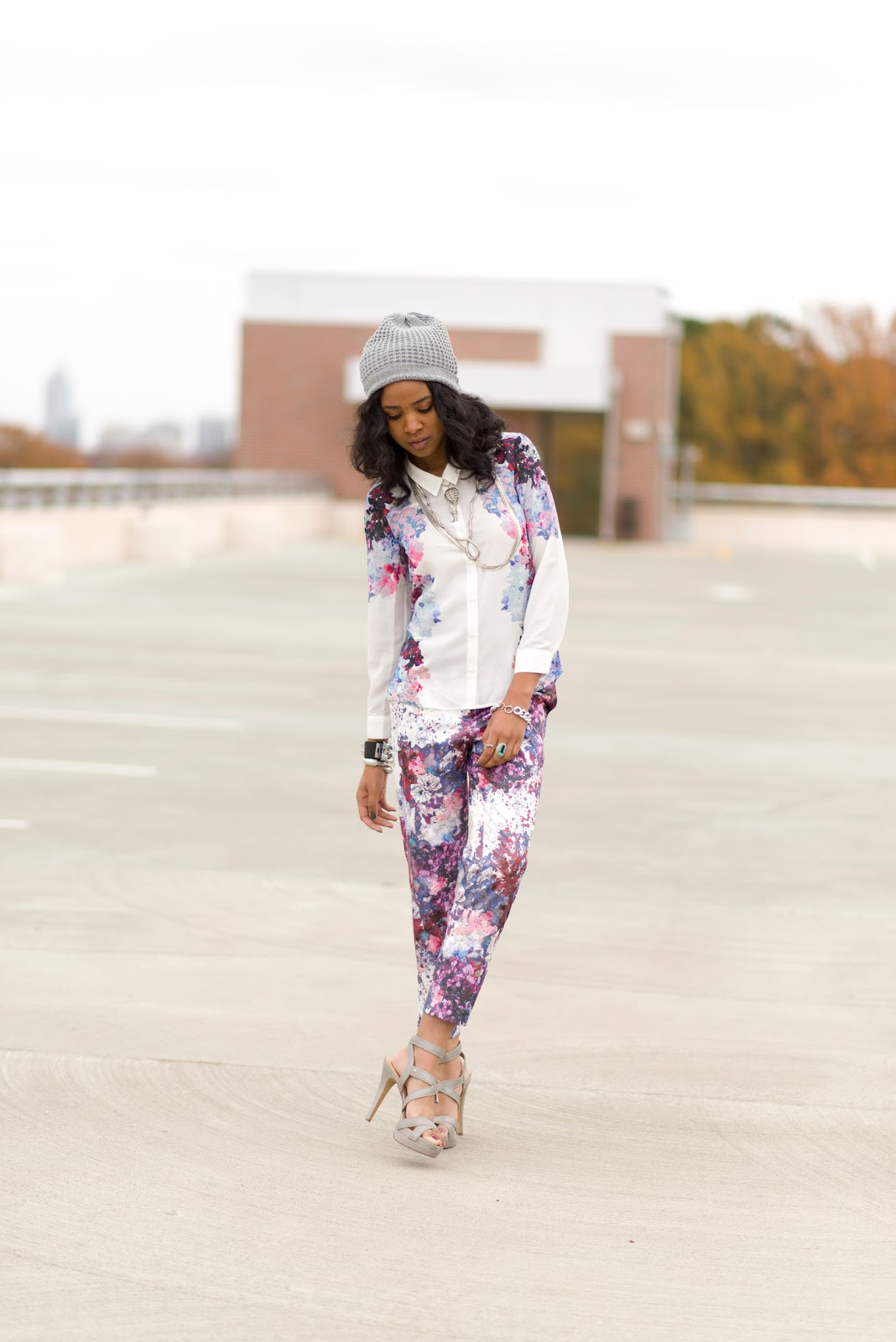 Jazsalyn is a Fashion design student at North Carolina State University and she's wearing a beautiful floral combination of pants and shirt with discrete silver accessories and grey heel sandals