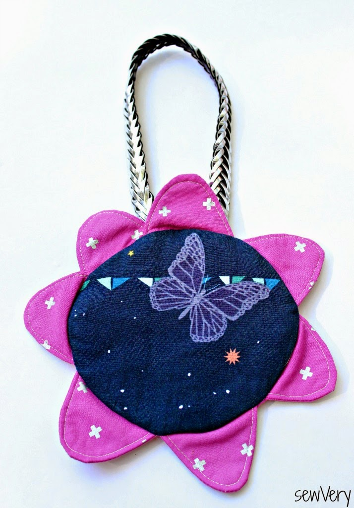 http://sewvery.blogspot.com/2014/10/perfect-petal-purse-pirates-treasure.html