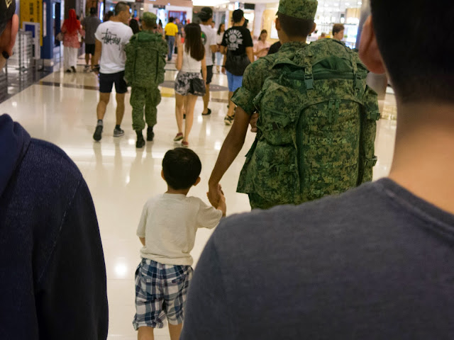 soldier holding his little brother's hand