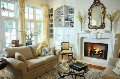 Decorated Sitting Room With Fireplace And Victorian Furniture