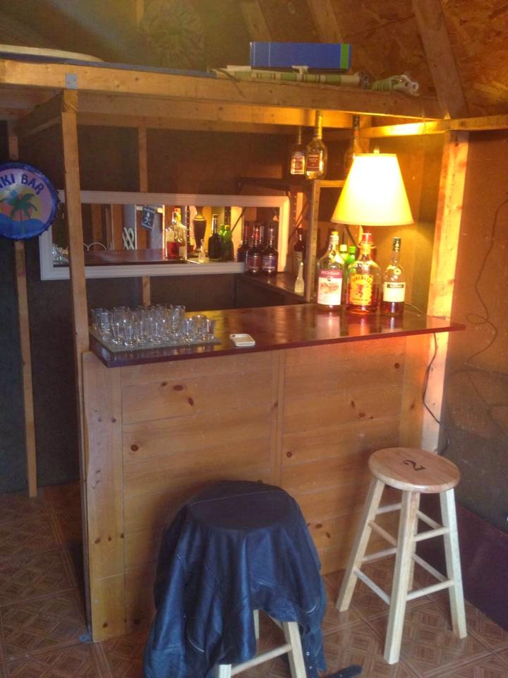 the barshed: shed into bar- bar with stools and light