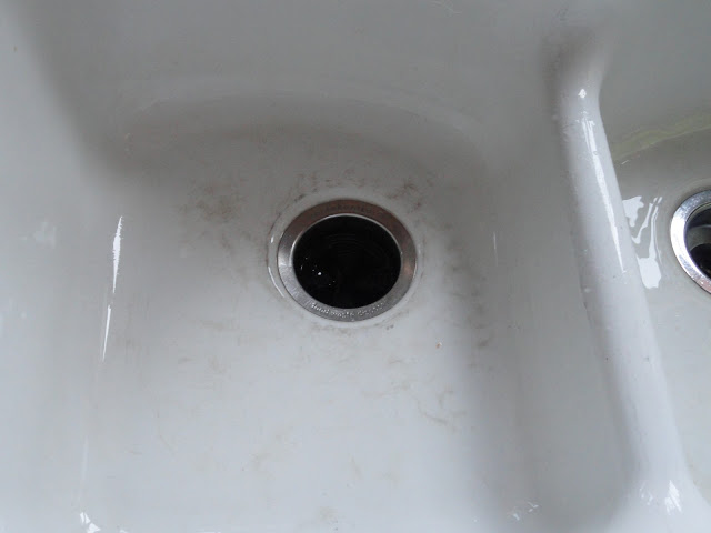 Black spots on porcelain sink