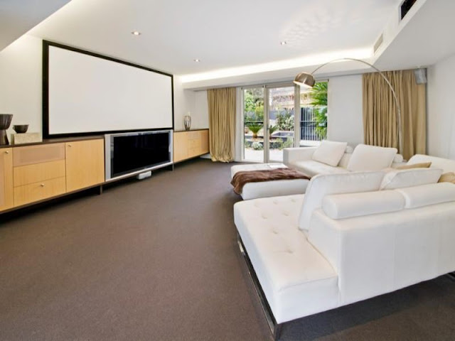Incredible home theater with white large sofa