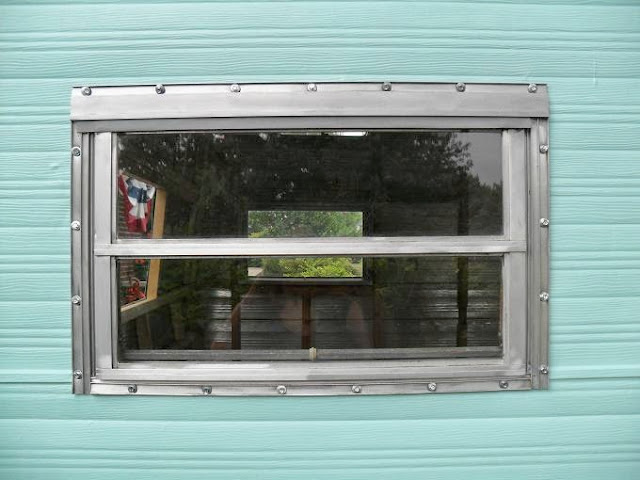 Town and prairie installing windows in a vintage camper for Windows for sale