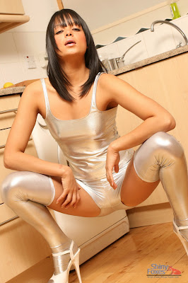 Squatting in tight shiny spandex shorts and stockings