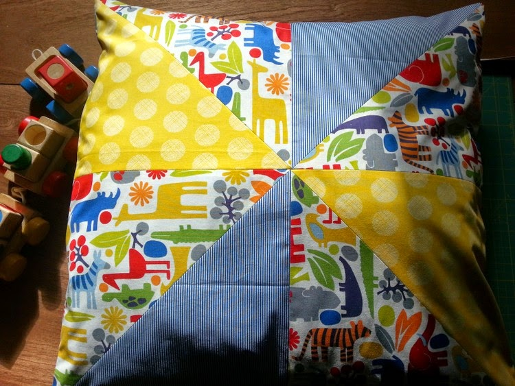 front side windmill patchwork reading cushion, featuring Alexander Henry 2D Zoo fabric