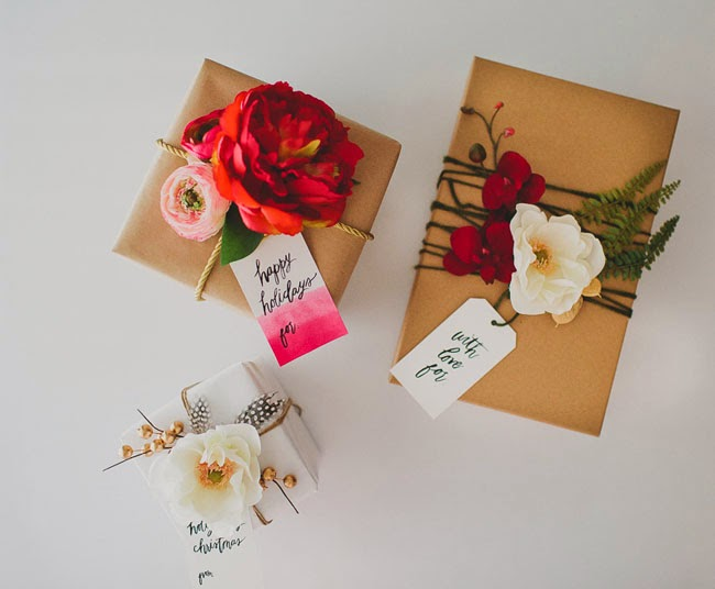 http://greenweddingshoes.com/diy-gift-wrap-with-silk-flowers-from-afloral/