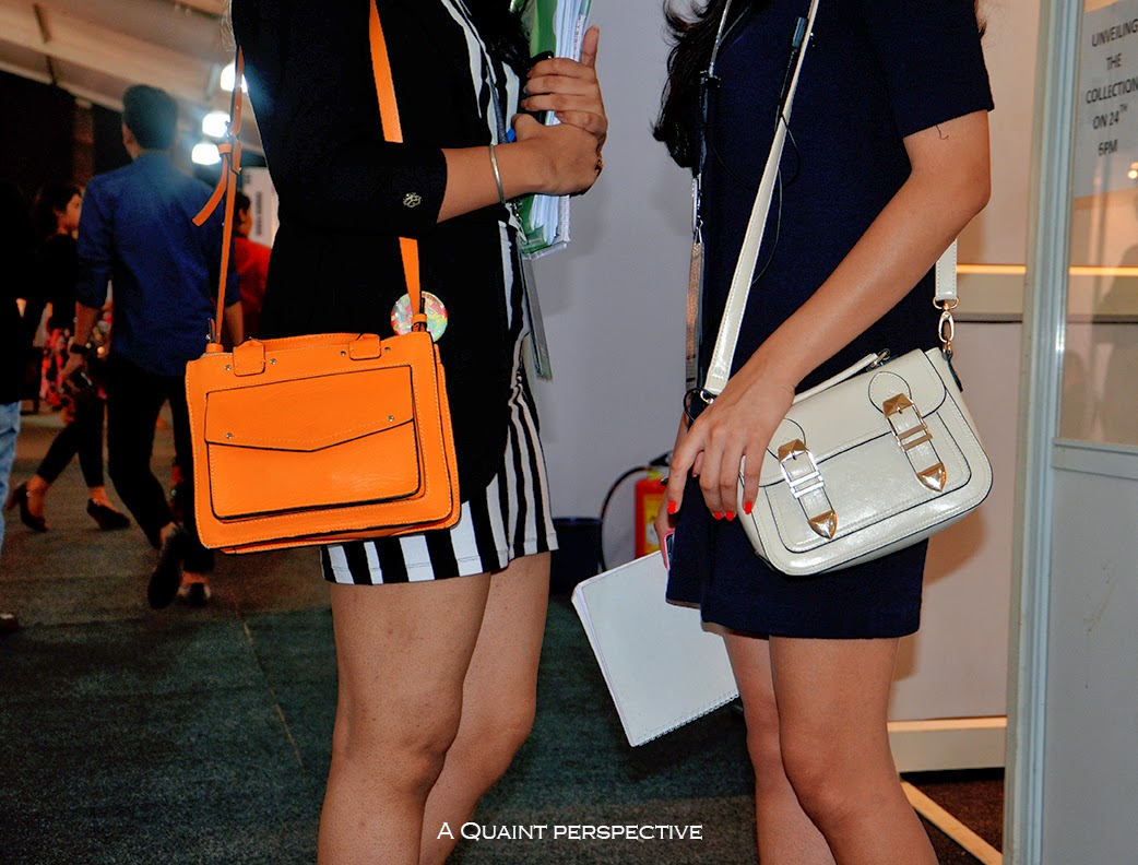 The chic ladies with their trendy handbags at LIFW.