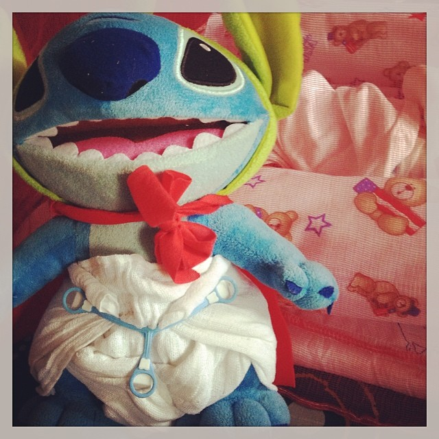 Practicing pre-fold cloth diapers on Stitch! He He He