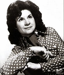 http://en.wikipedia.org/wiki/Kitty_Wells