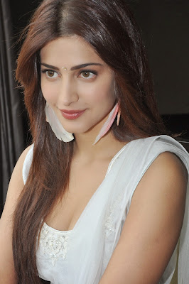 Shruti Haasan, Candid Photoshoot, bollywood actress, Indian Actress, Shruti Haasan Showcasing Her Stunning Figure In White Dress