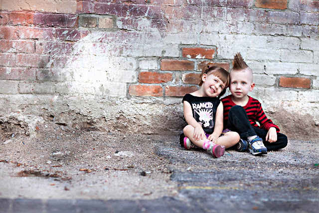 Little girl leans head on brother's shoulder during their mini photo session in downtown Tucson