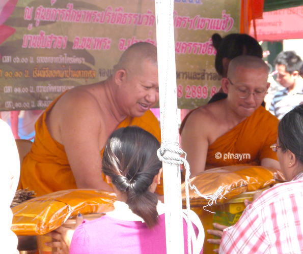 monks accepting gifts