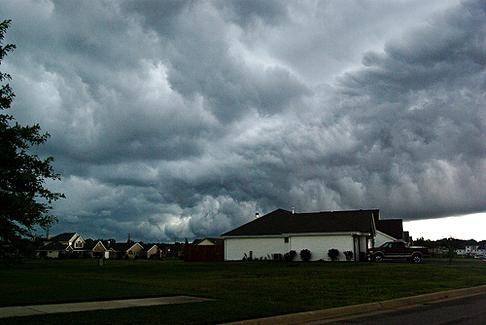 Dark stormy skies lurk above a neighborhood