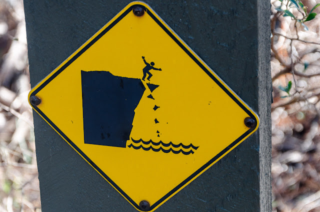 man falling on danger sign