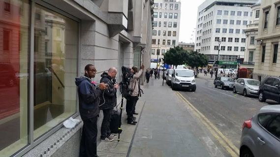 World press wait outside Charing Cross station to see Alison Madueke