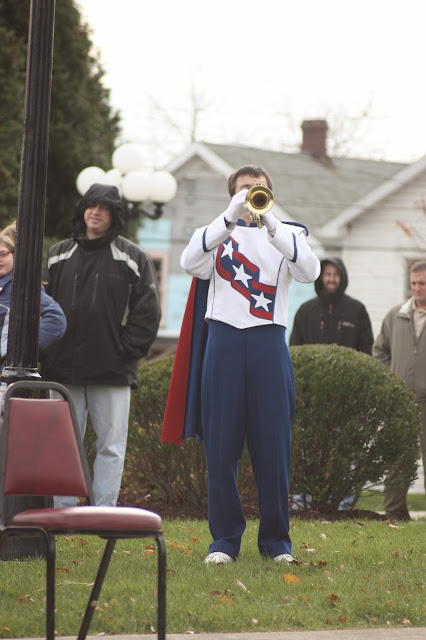 Trumpeter playing taps to honour fallen soldiers