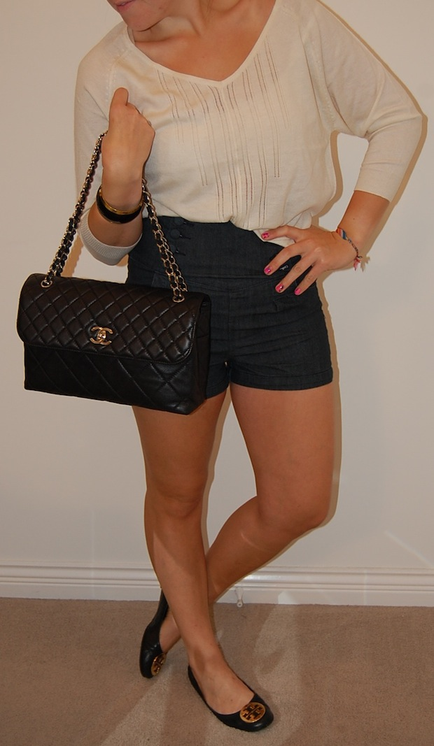 High-waist denim shorts and Tory Burch Reva flats.