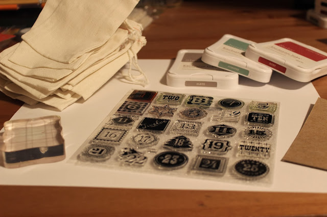 For this project, all you need are some stamp stencils, ink pads, and muslin bags