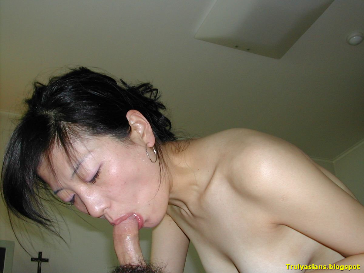 topless asian women giving blowjobs