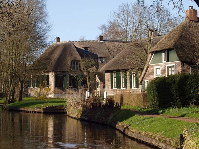 Giethoorn is called the Venice of the Netherlands because about 7.5km of canals run through the little village. Some 50 little wooden bridges span the canals. It was founded in around 1230 and originally called Geytenhorn, which over time has become Giethoorn.