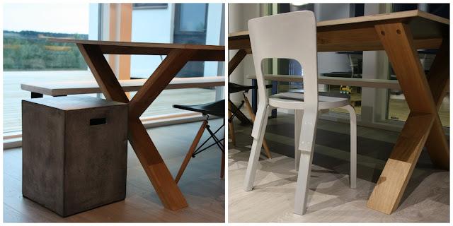Vepsäläisen betonijakkara ja Artekin uutta käsittelyä odottava tuoli.