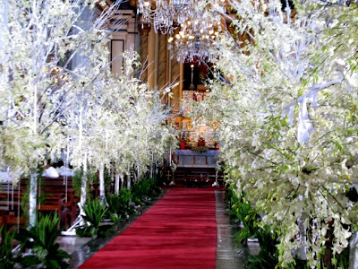 Expensive Cymbidium orchids adorning the aisle of San Agustin Church for Daniel-Katerina wedding scene