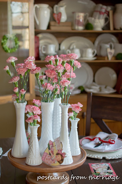 Pretty milk glass vases with carnations. So simple but so pretty. - Postcards from the Ridge
